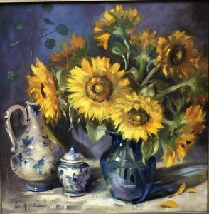 Still life painted in oil of sunflowers in a blue vase